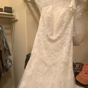 Brand new wedding dress with tags.
